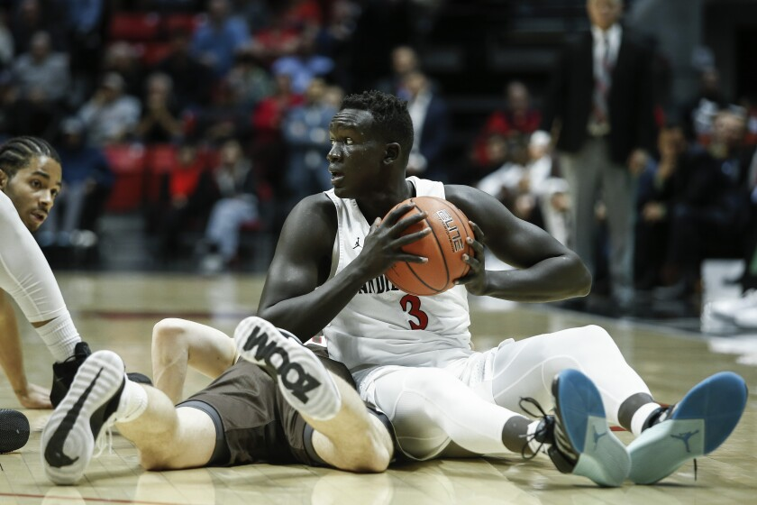 SDSU forward Aguek Arop (3) gets control of a loose ball in the first half against Brown.