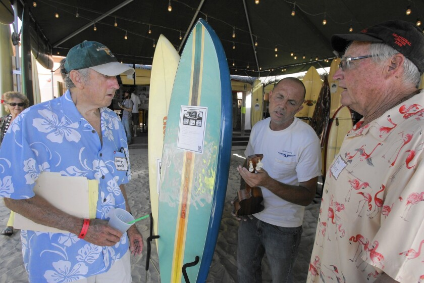 Larry Gordon, left, chats with Eric Huffman and Tom Morey at Gordon & Smith's 50th anniversary event in 2009.