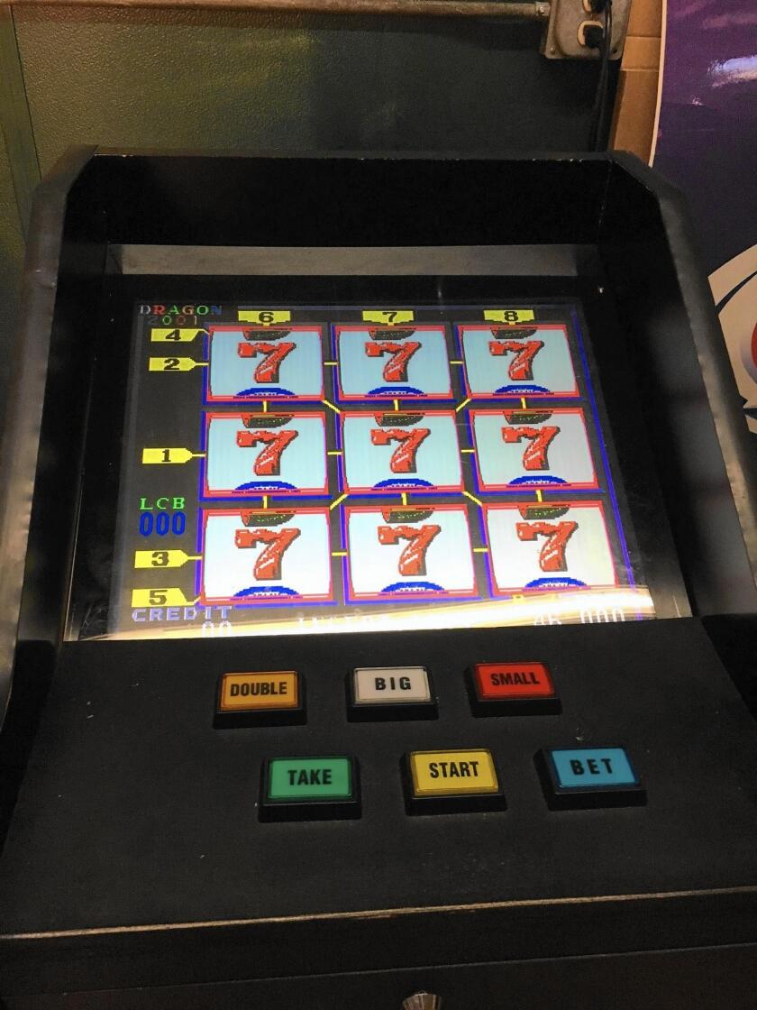 Illegal Gambling Machines Confiscated From Costa Mesa Liquor Store 4 Suspects Arrested Los Angeles Times