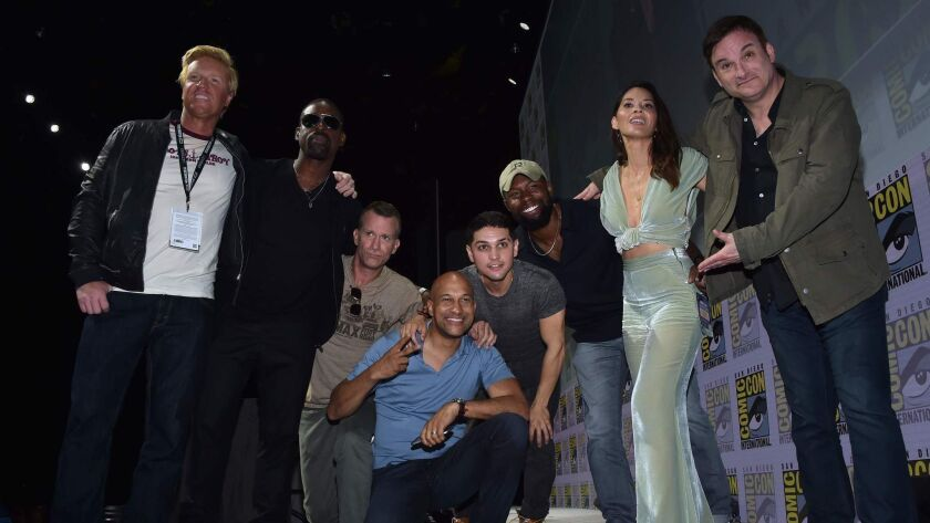 From left, actors Jake Busey, Sterling K. Brown, Thomas Jane, Keegan-Michael Key, Augusto Aguilera, Trevante Rhodes, Olivia Munn and director Shane Black promote 'The Predator' at Comic-Con in July.