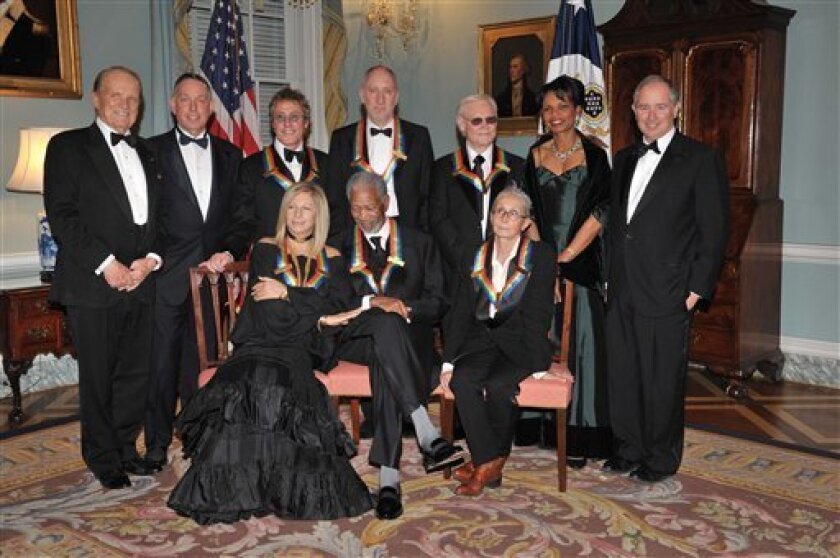 From left, Kennedy Center Honors producer George Stevens, Jr., Kennedy Center President Michael M Kiaser, Kennedy Center Honoree, Roger Daltrey, Barbara Streisand, Morgan Freeman, Pete Townshend, George Jones, Twyla Tharp, Secretary of State Condoleezza Rice, and Kennedy Center Chairman Stephen A. Schwarman pose for a group photo after the State Department Dinner for the Kennedy Center Honors gala Saturday, Dec. 6, 2008 at the State Department in Washington. (AP Photo/Kevin Wolf)