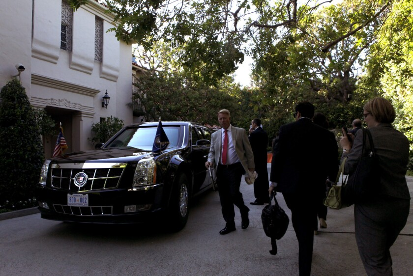 President Obama's car in front of the Bel-Air home of Alan and Cindy Horn.