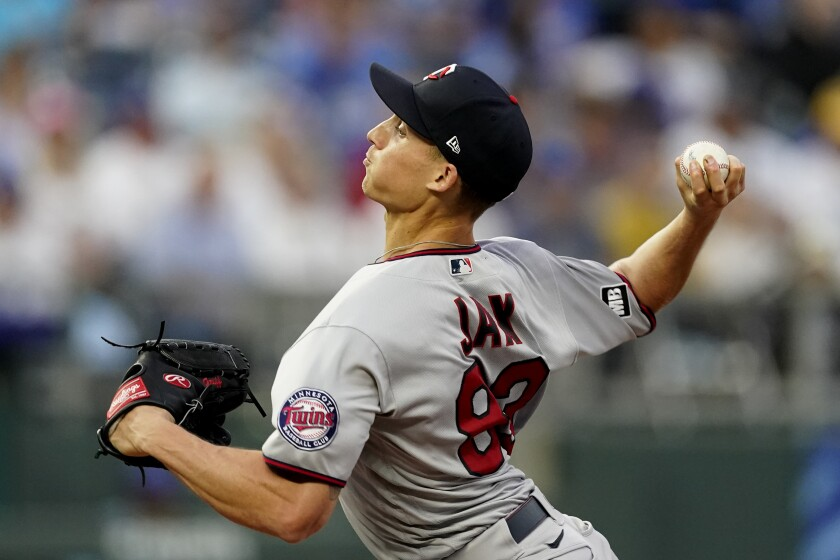 Minnesota Twins starting pitcher Griffin Jax throws during the first inning of a baseball game against the Kansas City Royals Saturday, Oct. 2, 2021, in Kansas City, Mo. (AP Photo/Charlie Riedel)
