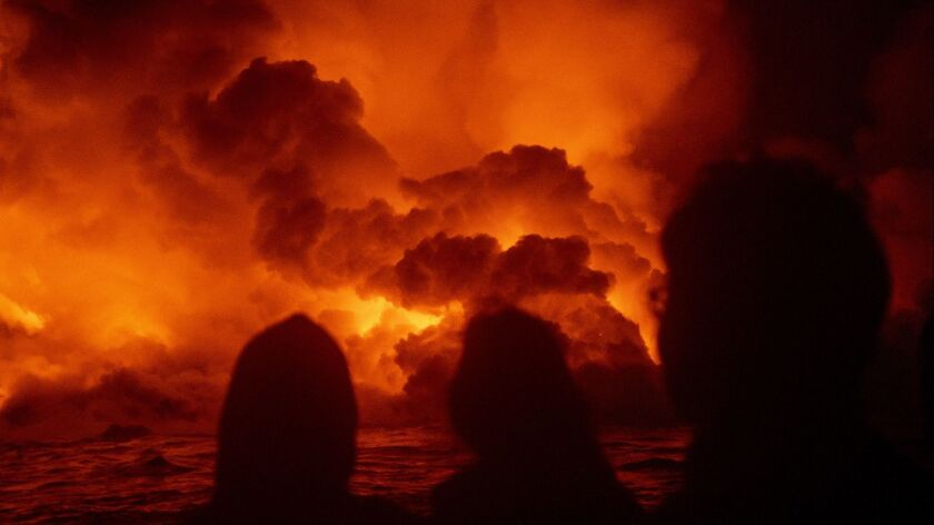 """PAHOA, HAWAII - JULY 02: People aboard Lava Ocean Tour's boat, """"Hot Shot,"""" off shore of what used to"""