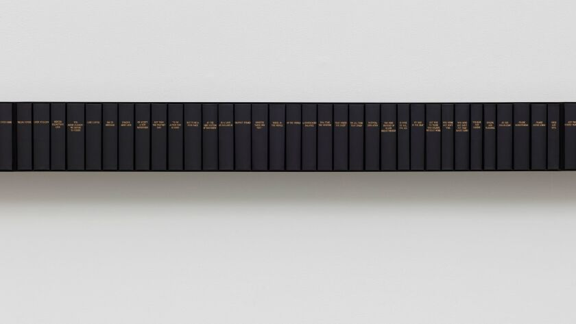 """Theaster Gates' """"Black Harmonics"""" (detail), 2017, bound Jet magazines, steel shelves, 8 1/4 inches by 196 7/8 inches by 6 3/8 inches."""