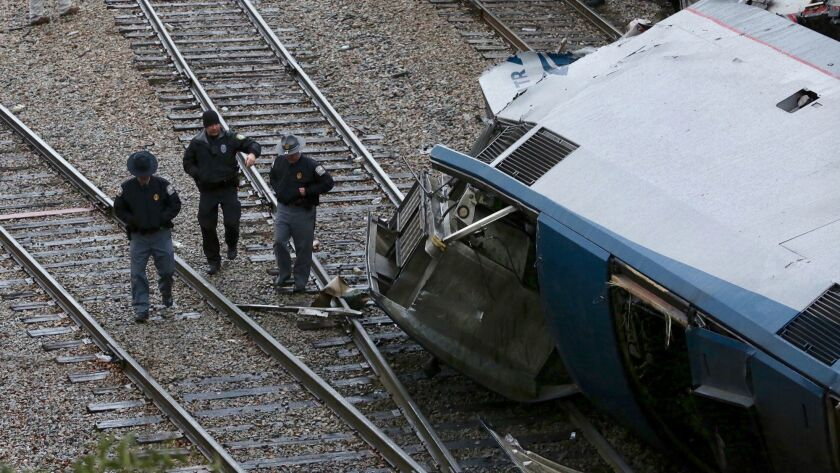 Authorities investigate the scene of a fatal Amtrak train crash in Cayce, South Carolina, Sunday, Fe