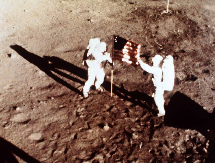 """Apollo 11 astronauts Neil Armstrong and Edwin E. """"Buzz"""" Aldrin, the first men to land on the moon, plant the U.S. flag on the lunar surface."""