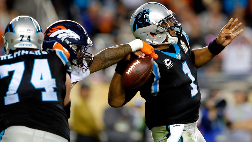 Broncos linebacker Von Miller (58) strips the ball from Panthers quarterback Cam Newton (1) during the fourth quarter.