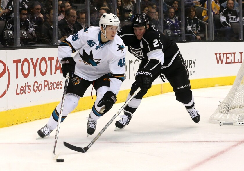 San Jose's Tomas Hertl controls the puck in front of the Kings' Matt Greene at Staples Center on Oct. 30. Greene was to be placed on long-term injured reserve with an upper-body injury.
