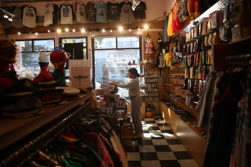 Xochitl Silva organizes the shelves at Popkiller Second.
