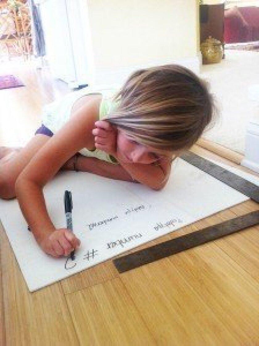 ipples at work, designing her Milkshake balance board. Courtesy