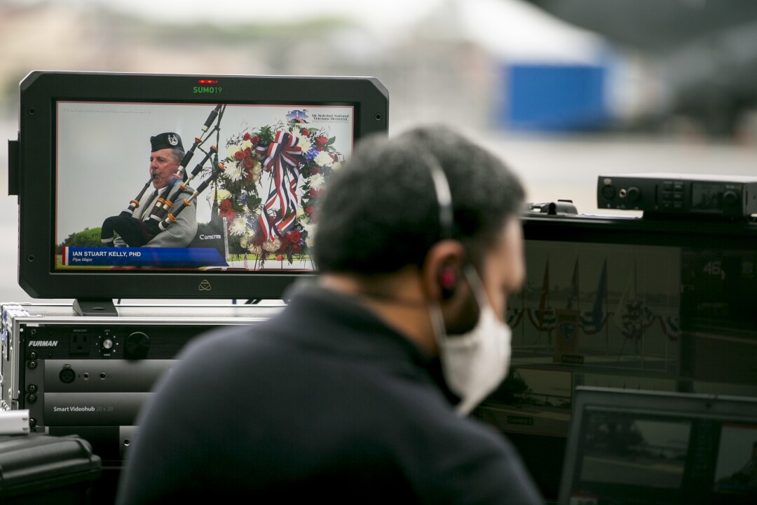 Production crews watch the live broadcast from around the county during a Memorial Day service aboard the USS Midway Museum.