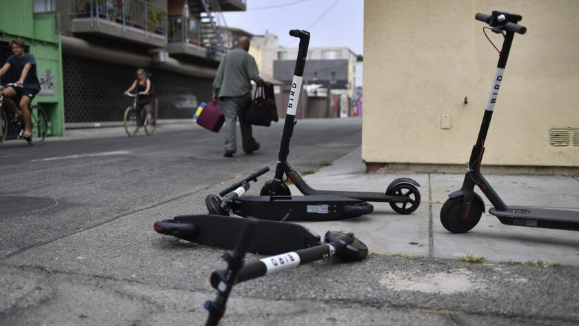 VENICE, CA - July 25, 2018 Bird and Lime electric scooters are discarded near the Venice Beach Board