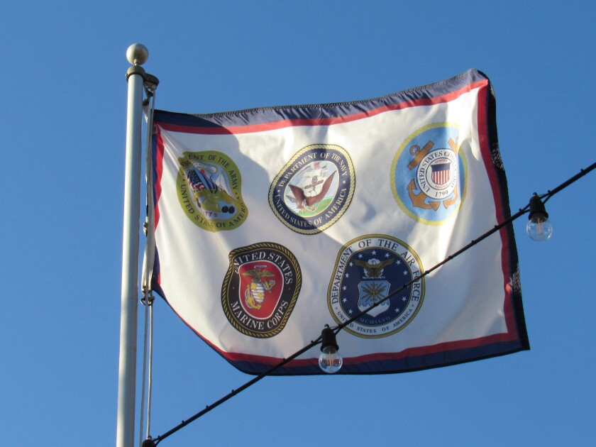 A flag honoring the military that is part of a Veterans memorial waves in the air near City Hall in El Cajon.