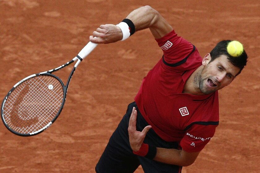 Serbia's Novak Djokovic serves the ball to Austria's Dominic Thiem during their semifinal match of the French Open tennis tournament at the Roland Garros stadium, Friday, June 3, 2016 in Paris. (AP Photo/Christophe Ena)