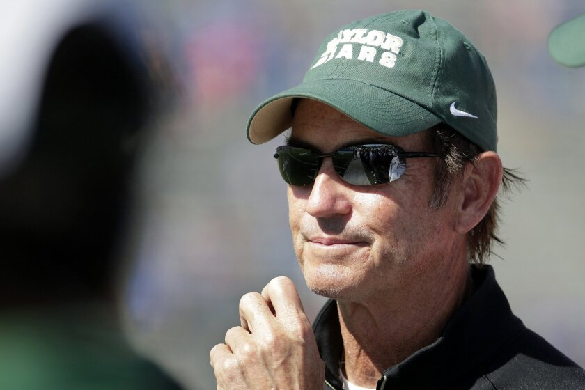 FILE - In this Oct. 10, 2015, file photo, Baylor head coach Art Briles watches during the second half of an NCAA college football game against Kansas in Lawrence, Kan. Baylor University's board of regents says it will fire Briles and re-assign university President Kenneth Starr in response to quest