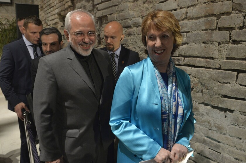 Catherine Ashton, the European Union foreign policy chief, and Iranian Foreign Minister Mohammad Javad Zarif leave a press briefing July 18 in Vienna.