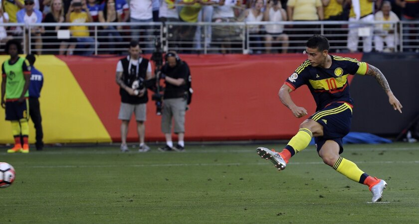 Colombia's James Rodriguez kicks the ball to score a penalty against the U.S. during the opening match of the Copa America Centenario at Levi's Stadium in Santa Clara, Calif., Friday, June 3, 2016. (AP Photo/Jeff Chiu)