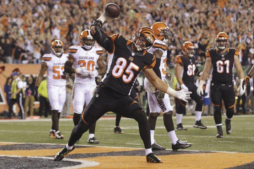 Cincinnati Bengals tight end Tyler Eifert (85) celebrates after scoring a touchdown during the first half of an NFL football game against the Cleveland Browns, Thursday, Nov. 5, 2015, in Cincinnati. (AP Photo/Darron Cummings)