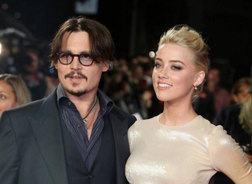 """ARCHIVO - En esta fotografía de archivo del 3 de noviembre de 2011, los actores estadounidenses, Johnny Depp, y Amber Heard, llegan para el estreno europeo de su película """"The Rum Diary"""" en Londres. (AP Foto/Joel Ryan, Archivo)"""