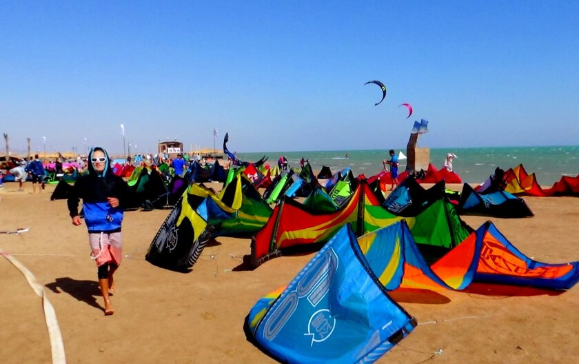 A man makes his way before the first stage of the world kite boarding championship begins in Egypt's Red Sea resort of el-Gouna, Monday, March 21, 2016. Competition for the world kiteboarding championship has kicked off in el-Gouna, with 65 contestants from 26 countries shooting across the water and twirling through the air in hopes of winning 50,000 euros ($56,000) in prizes. (AP Photo/Brian Rohan)