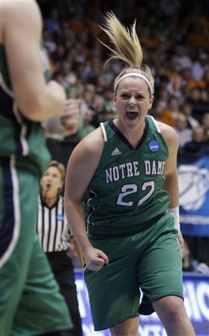 Notre Dame guard Brittany Mallory (22) cheers after a teammate scored against Tennessee in the first half of the NCAA women's college basketball tournament regional final, Monday, March 28, 2011, in Dayton, Ohio. (AP Photo/Al Behrman)