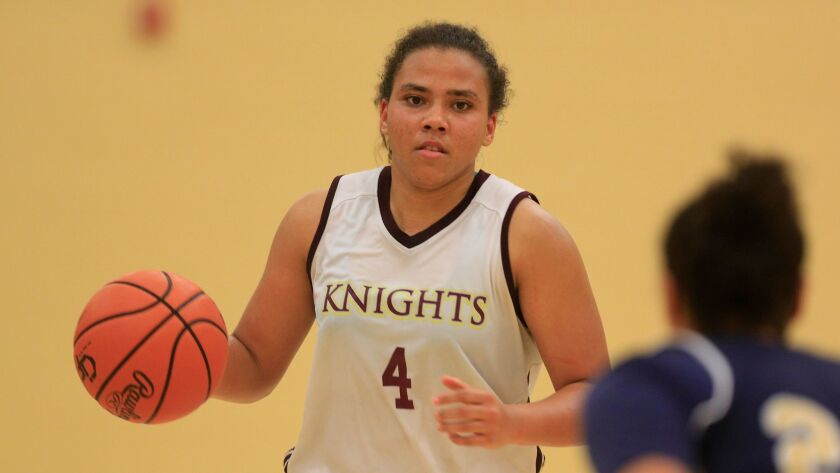 Destiny Littleton, who will attend USC, scored 27 points and grabbed 11 rebounds in the Knights' win Tuesday night.