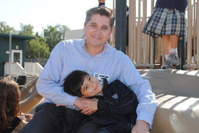 Horizon Prep 1st grader Justin Hernandez with his dad, Johnny.