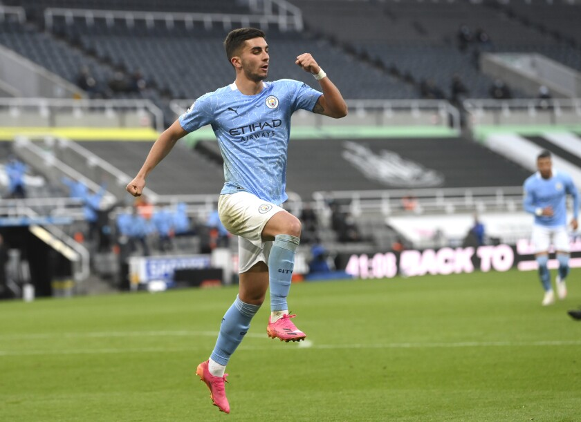 Manchester City's Ferran Torres celebrates after scoring his side's second goal during the English Premier League soccer match between Newcastle United and Manchester City at St James' Park stadium, in Newcastle, England, Friday, May 14, 2021. (Stu Forster/Pool via AP)