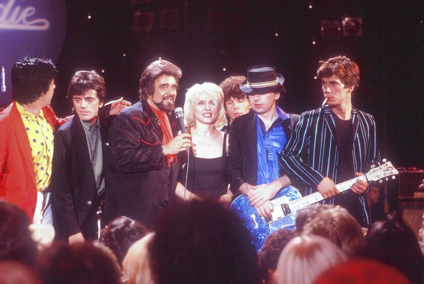 """Debbie Harry and her band Blondie perform on """"The Midnight Special,"""" with host Wolfman Jack, in 1979."""