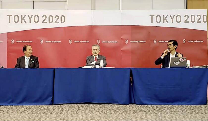 el presidente del comité organizador Yoshiro Mori y el directorgeneral Toshiro Muto
