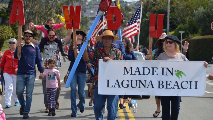 The Sawdust Art and Craft Festival participants marched along Park Ave. during the 51st Annual Lagun