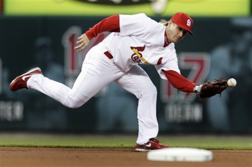 St. Louis Cardinals shortstop Khalil Greene can't come up with a ball hit for a single by Pittsburgh Pirates' Freddy Sanchez during the first inning of a baseball game Wednesday, April 8, 2009, in St. Louis. (AP Photo/Jeff Roberson)