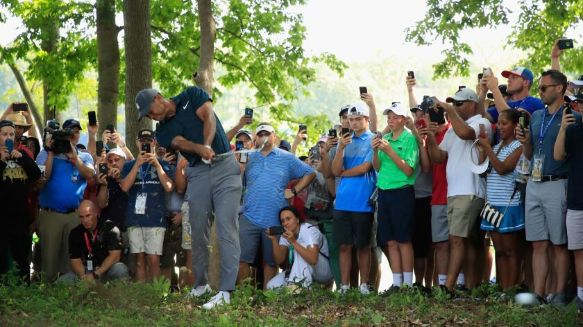 Tiger Wood plays a shot on the 15th hole during the first round of the 2018 PGA Championship at Bellerive Country Club.