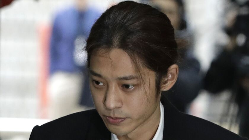 K-pop singer Jung Joon-young arrives for a hearing at the Seoul Central District Court on March 21.