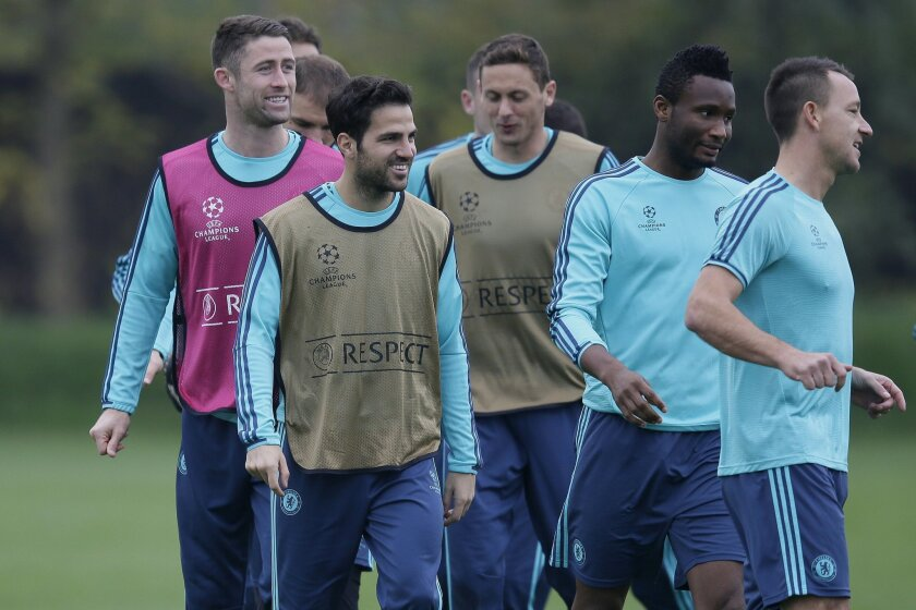 Chelsea's, left to right, Gary Cahill, Cesc Fabregas, Nemanja Matic, Kurt Zouma and John Terry warm up during a training session at the team's training ground in Cobham, England, Tuesday Nov. 3, 2015. Chelsea will play Dynamo Kyiv in a Group G match on Wednesday. (AP Photo/Tim Ireland)