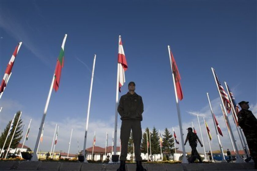 An Austrian soldier members of EUFOR (European Union Forces) peacekeeper forces guards NATO headquarters, prior to the meeting between Bosnia's top officials and foreign diplomats in Sarajevo's suburb of Butmir, Friday, Oct. 9, 2009. European and U.S. officials are meeting with Bosnian leaders to outline a plan on how to overcome the stalemate that keeps Bosnia behind other regional countries seeking to join the EU and NATO. (AP Photo/Amel Emric)