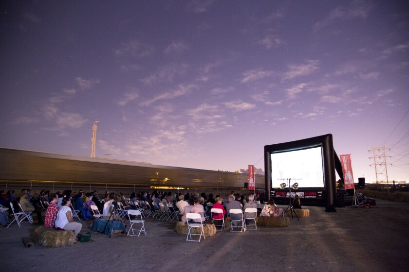 The Ambulante Documentary Film Festival will screen documentaries in public locations around Los Angeles for three weeks starting Sept. 19. Seen here: a screening from last year's festival at a space along the L.A. River run by the cultural group Clockshop.