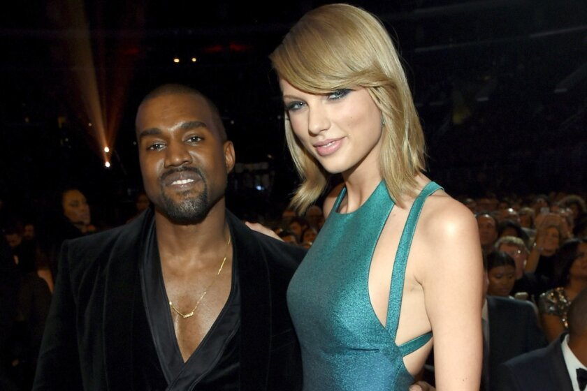 Recording Artists Kanye West and Taylor Swift attend The 57th Annual Grammy Awards at the Staples Center on Sunday in Los Angeles, California.