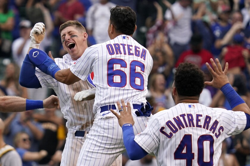 Chicago Cubs' Frank Schwindel, left, celebrates with Rafael Ortega, center, and Willson Contreras after hitting the game-winning single against the Pittsburgh Pirates in the ninth inning of a baseball game in Chicago, Saturday, Sept. 4, 2021. The Cubs won 7-6. (AP Photo/Nam Y. Huh)