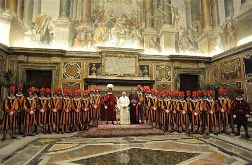 In this photo provided by the Vatican newspaper L'Osservatore Romano, Pope Benedict XVI meets new Vatican Swiss Guards and their families , in the Vatican's Clementina Hall, Friday, May 6, 2011 prior to their swearing-in ceremony. The swearing in ceremony is held each May 6 to commemorate the day i