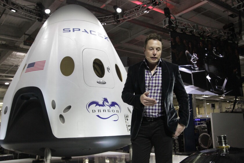 SpaceX Chief Executive Elon Musk introduces the Dragon V2 at the company's Hawthorne facility in May. The Dragon V2 is intended to carry astronauts into space.