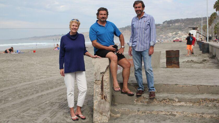 La Jolla Shores Association board members Angie Preisendorfer, Richard 'Monte' Montemarano and John Sheridan show the damages on the southern beach access of La Vereda boardwalk.