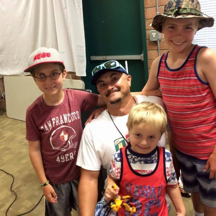 Robby Medina, center, with Seany Foundation campers.