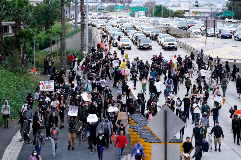 Protesters, outraged over the death of George Floyd, take to the streets in downtown L.A. on May 29, 2020.