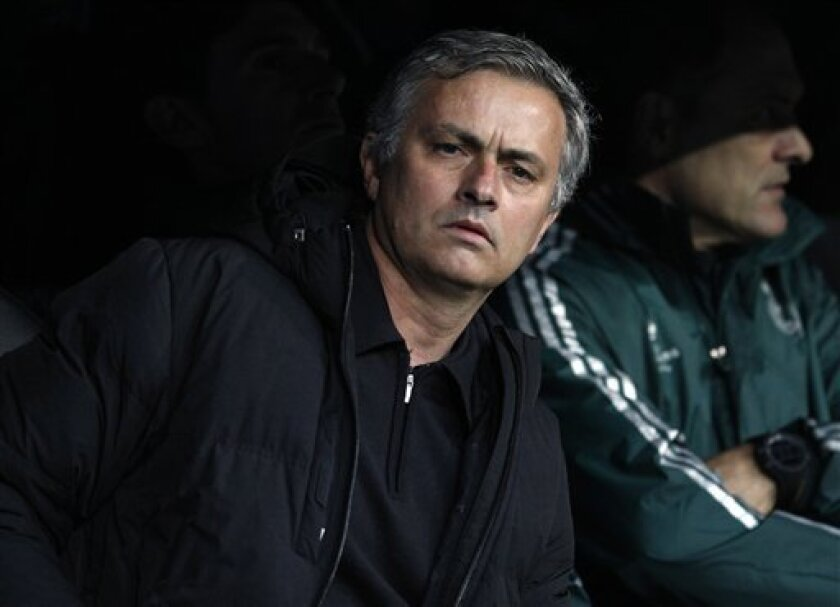 Madrid coach Jose Mourinho from Portugal sits on the bench prior to the Champions League semifinal second leg soccer match between Real Madrid and Borussia Dortmund at the Santiago Bernabeu stadium in Madrid, Spain, Tuesday April 30, 2013. (AP Photo/Alberto Di Lolli)