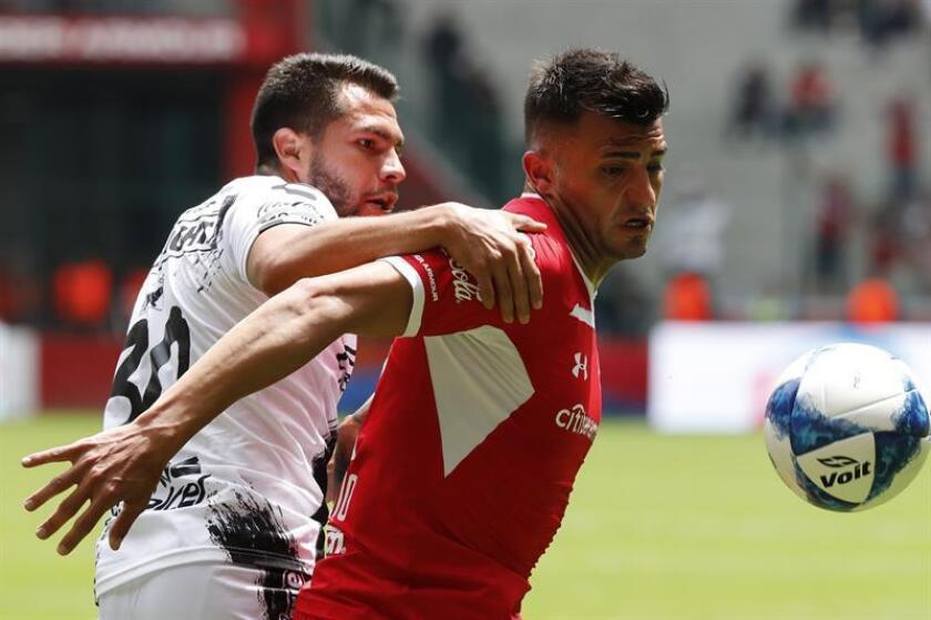 The Toluca player Enrique Triverio (r) vies for the ball with Ihiram Muñoz (L) on Sunday, 19, 2018 in the Nemesio Diez stadium in Toluca, Mexico. EPA- EFE/Jorge Núñez
