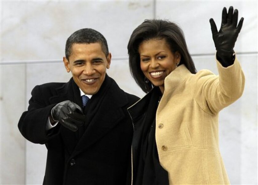 "President-elect Barack Obama and his wife Michelle Obama, arrive at ""We Are One: Opening Inaugural Celebration at the Lincoln Memorial"" Sunday, Jan. 18, 2009, in Washington.  (AP Photo/Alex Brandon)"