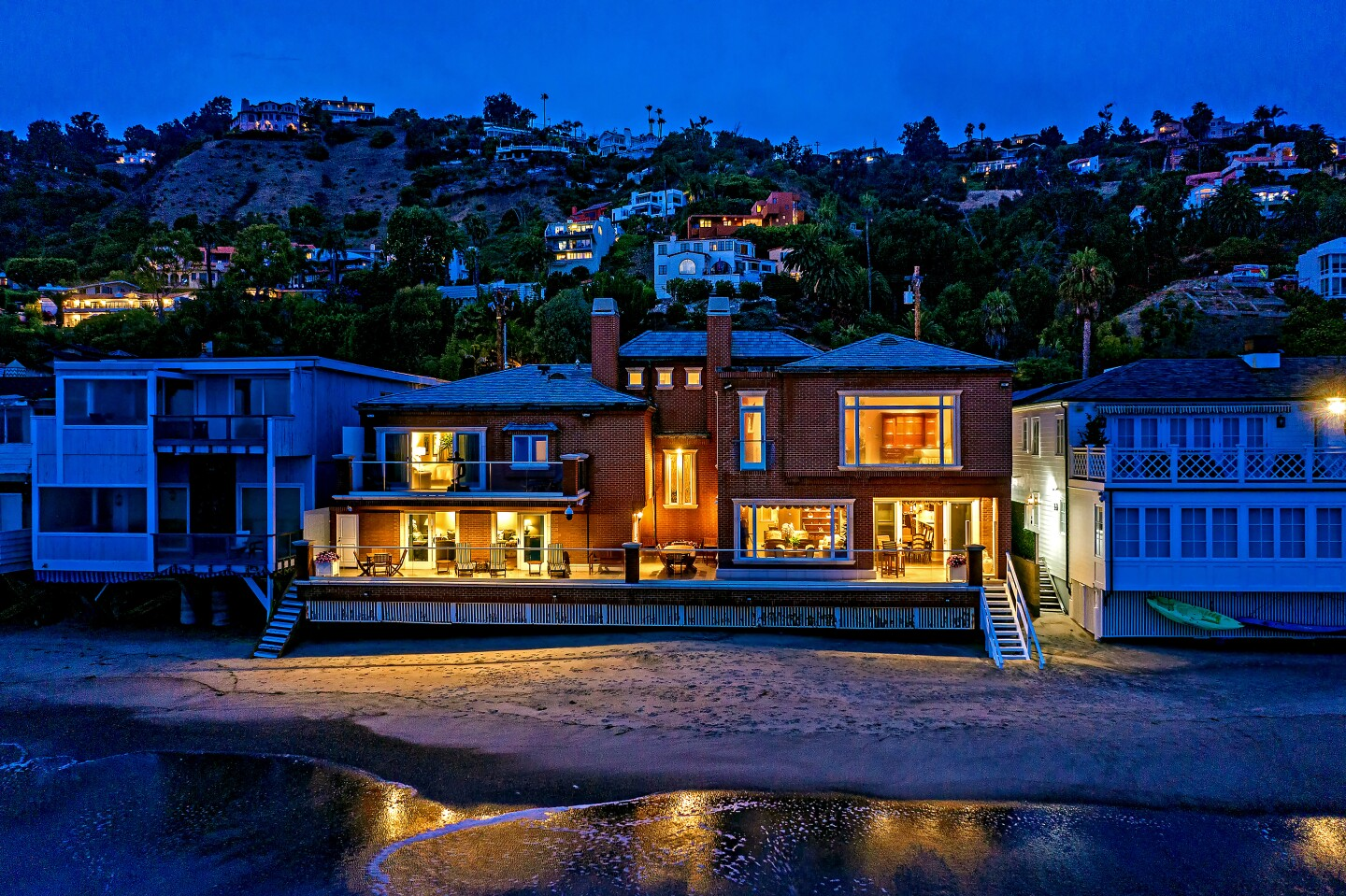 Socialite Candy Spelling has listed her oceanfront home in Malibu for sale at $23 million. The brick-clad residence sits on 81 feet of beach frontage on La Costa Beach. Inside, rooms features limestone floors, crown molding and other custom details.