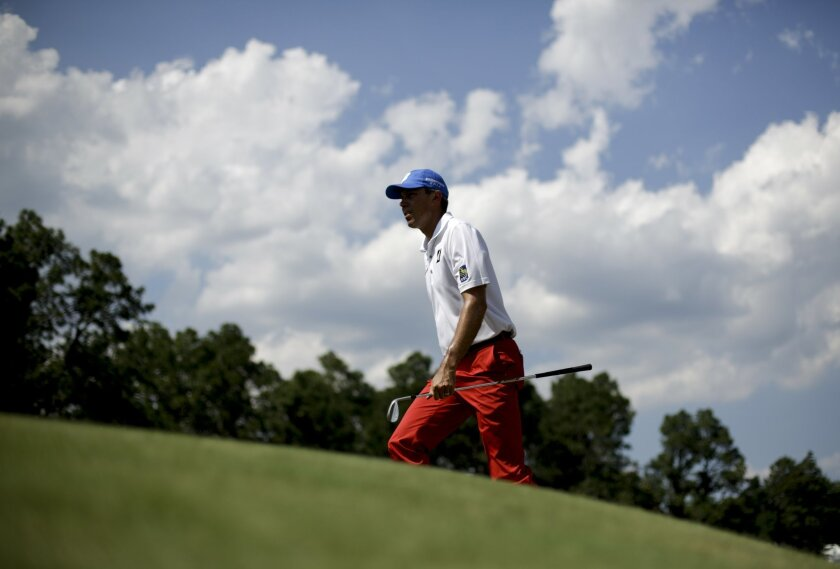 Matt Kuchar walks to the fifth green during a practice round for the U.S. Open golf tournament in Pinehurst, N.C., Tuesday, June 10, 2014. The tournament starts Thursday. (AP Photo/David Goldman)